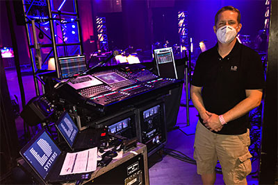 LD Systems Audio Department Operations Manager Thomas Ruffner at the event's DiGiCo SD10 monitor console