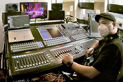 Rafael Rosales manning the broadcast mix from Jones Hall's ticket booth for ABC 13 on a DiGiCo SD10