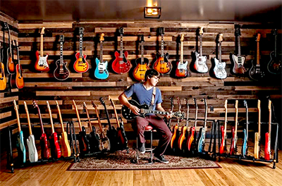 Dillon Taylor with his Guitar Collection at Dillon's Garage