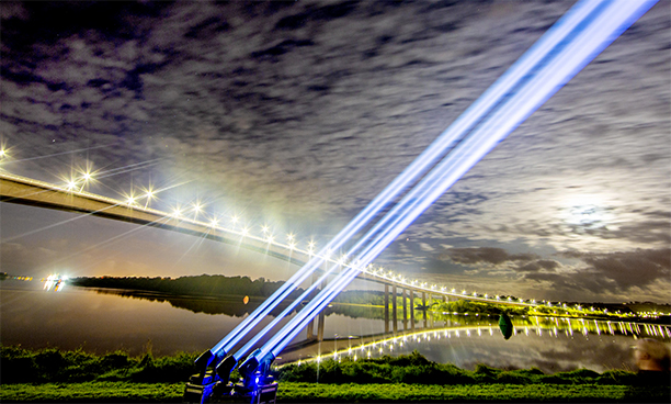 Spotlights over the Foyle Bridge, Derry, as part of the Global Industry Awareness Day for the Production Services and Live Events sector