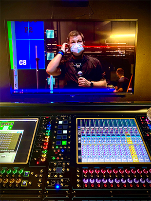 Monitor engineer Matt Russell on the iHeartRadio Theater stage, seen on the display over the DiGiCo Quantum338 monitor console