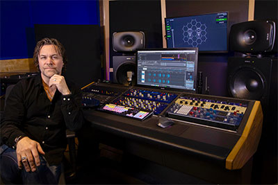 Maxe Axelsson with new Genelec monitoring system at PAMA Records